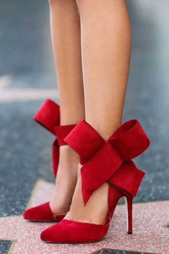 red suede shoes with large bows on the ankle will be amazing for a short wedding dress