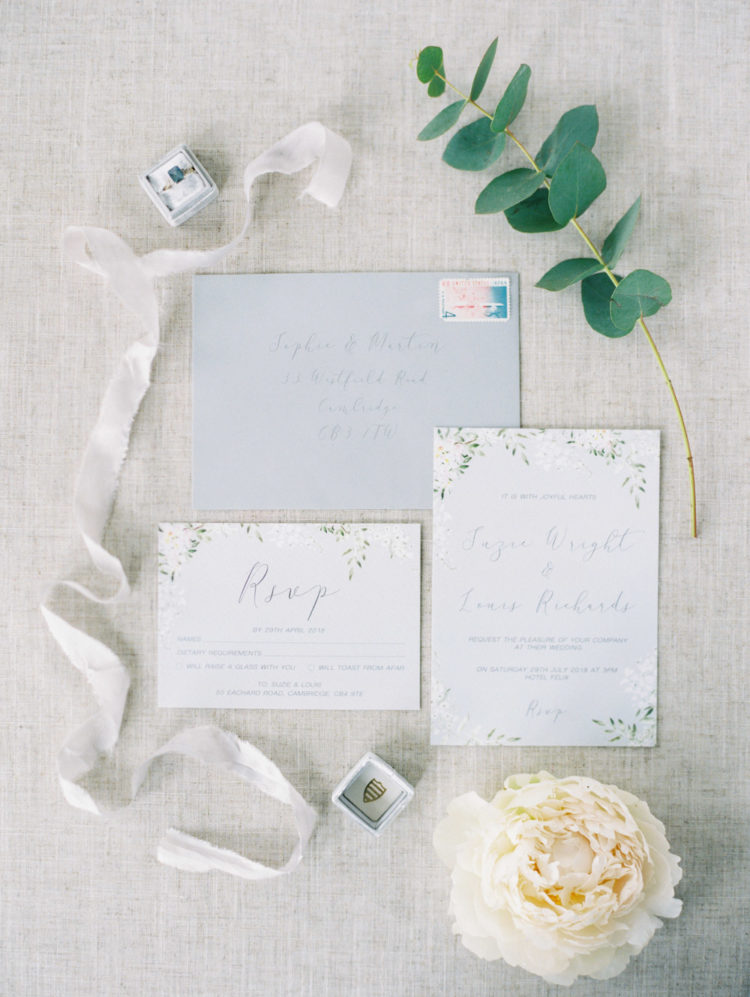 Neutral wedding stationery with greenery touches