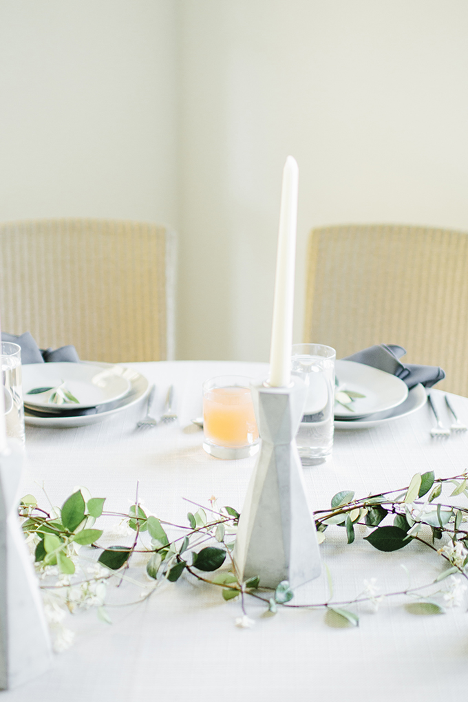 The table was styled very simply, with some greenery, geo concrete candle holders and neutral textiles
