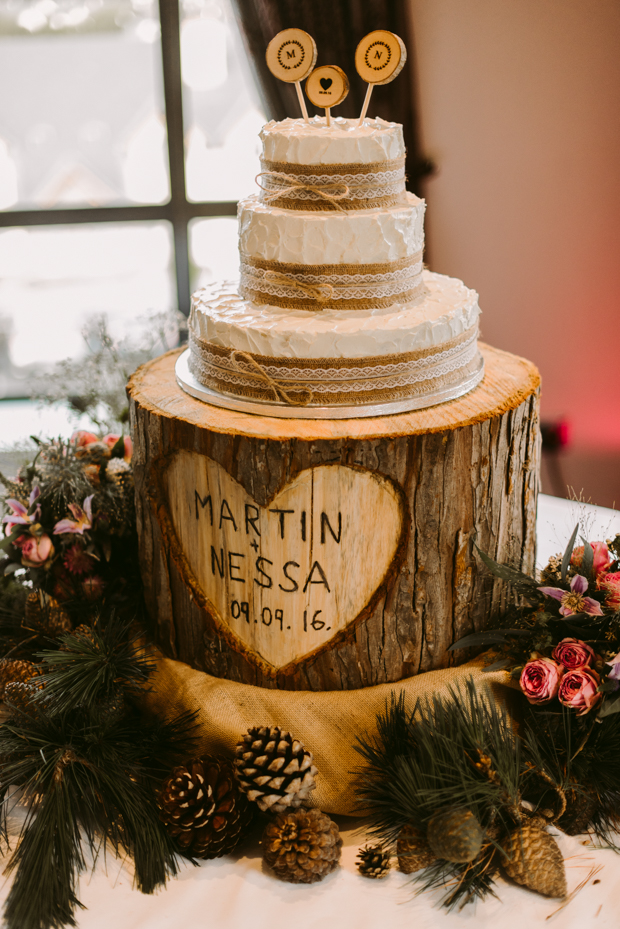 The wedding cake was also rustic, decorated with burlap and lace and with wood slice toppers