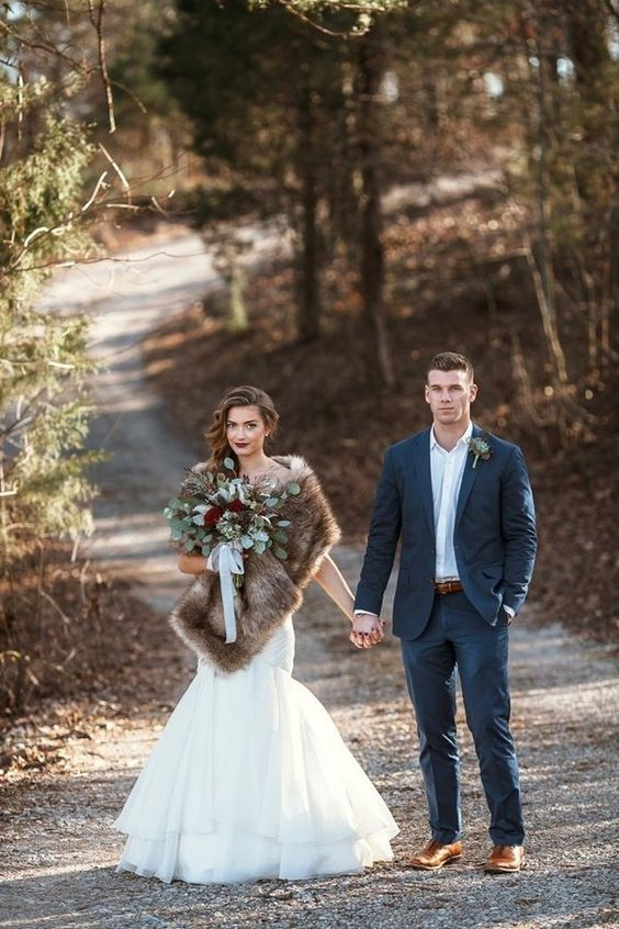 a gorgeous mermaid wedding dress, a luxe faux fur coverup and a dark lip for a refined look