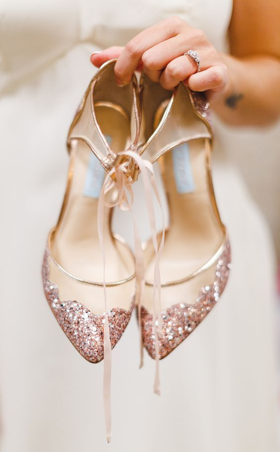 sheer wedding shoes decorated with pink sparkles and ribbons
