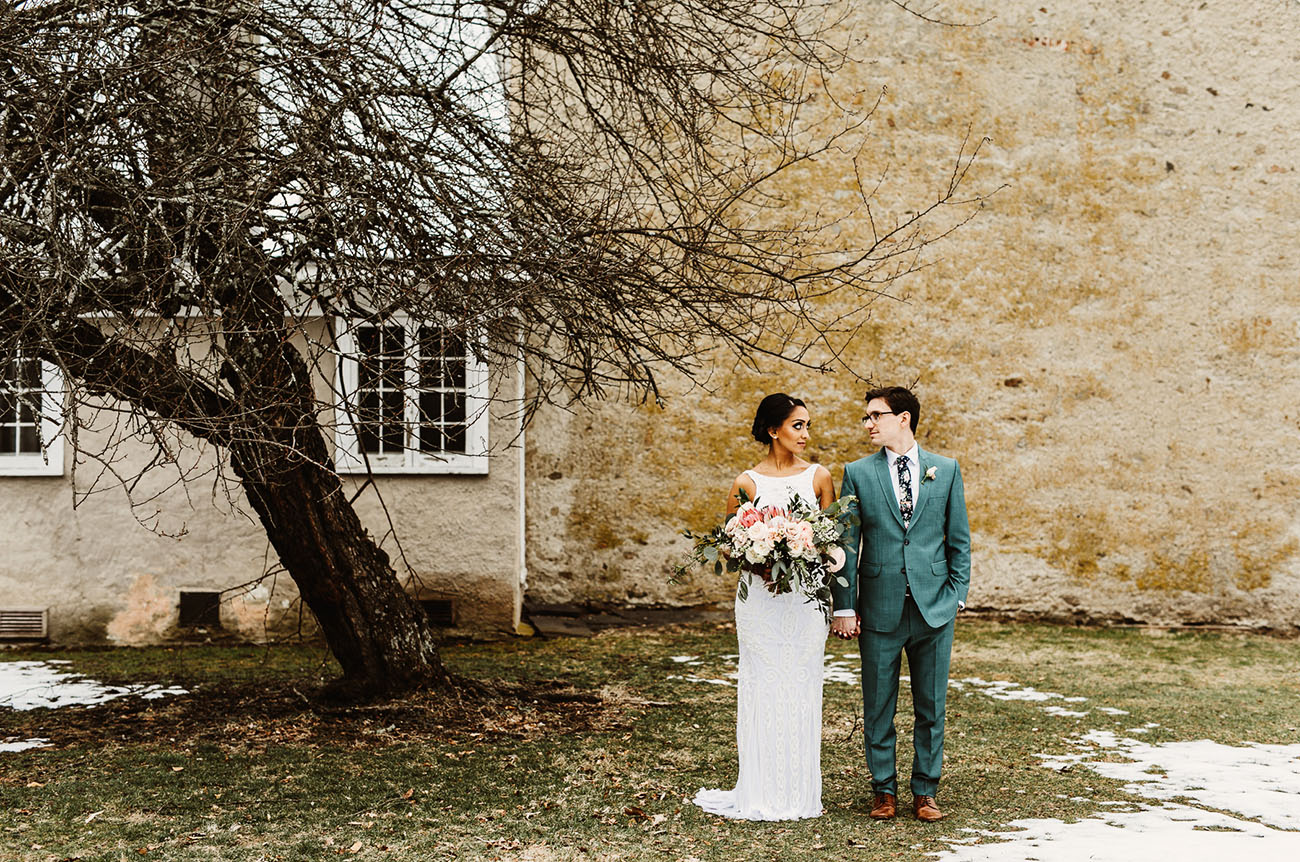 After that the couple dressed up into more European clothes   the groom was wearign a seafoam green suit and the bride was wearing a modern wedding gown