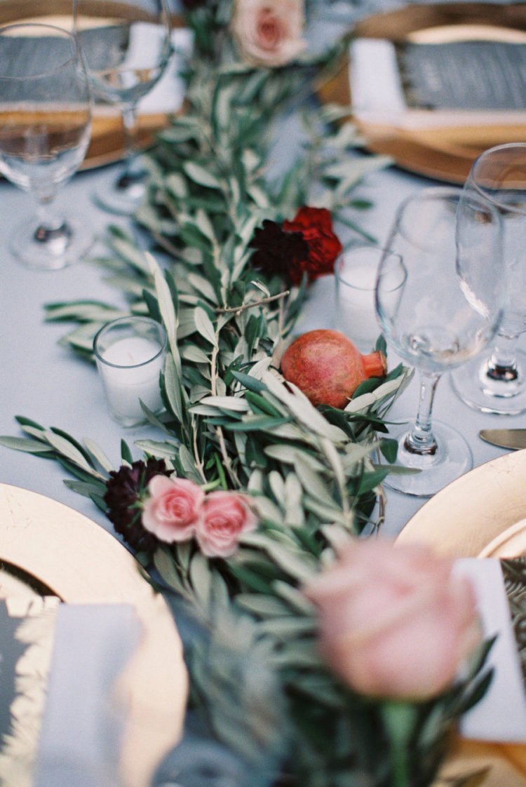 Pomegranates and bold blooms here and there gave a colorful touch to the tablescape
