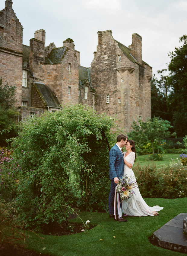 The backdrop of a gorgeous Scottish castle is a perfect one for a refined couple