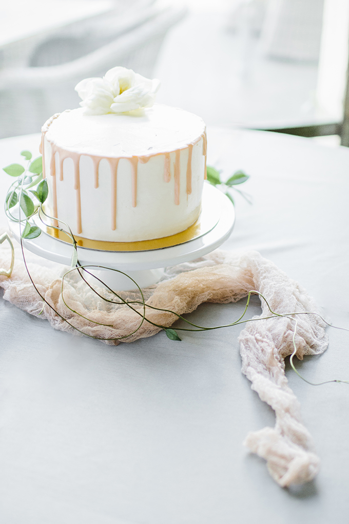 The wedding cake was a simple white one, with honey drip and a fresh bloom