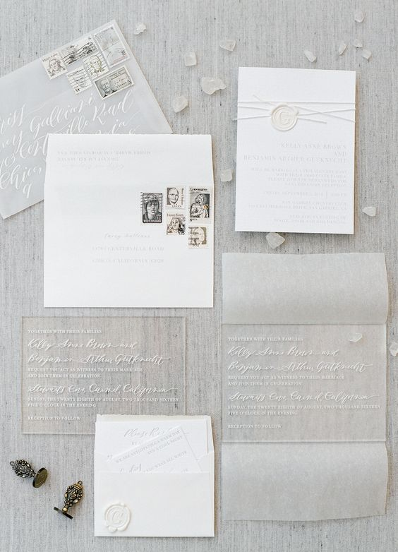 acrylic and paper pressed wedding invitations in sheer envelopes for an ethereal wedding