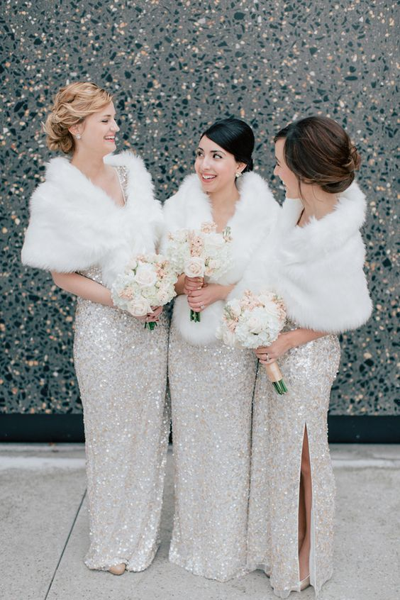 silver sequin maxi gowns with side slits, white faux fur coverups fo glam bridesmaids' looks