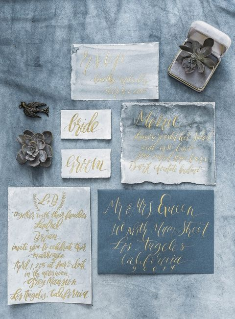 winter wedding invitation suite in the shades of grey and blue, with gold calligraphy and watercolor