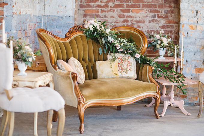 The lounge was decorated with refined upholstered furniture and lush greenery and blooms