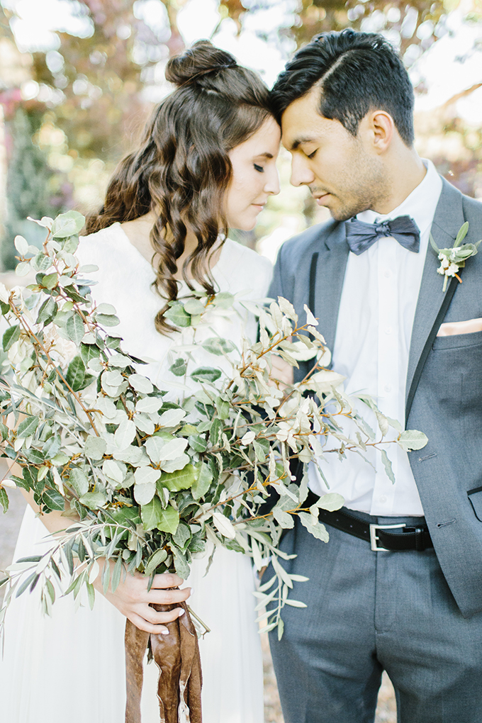 The wedding bouquet was done only of greenery, no flowers, and with a leather ribbon
