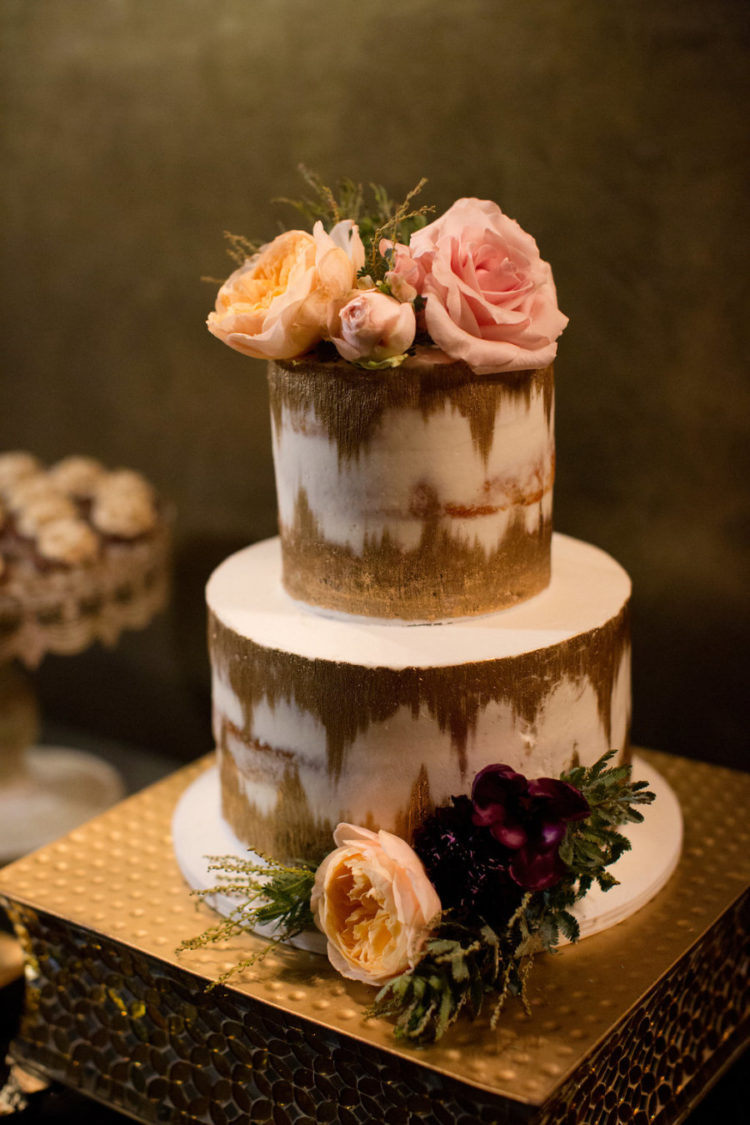 The wedding cake was ikat, with gold and white touches and fresh blooms