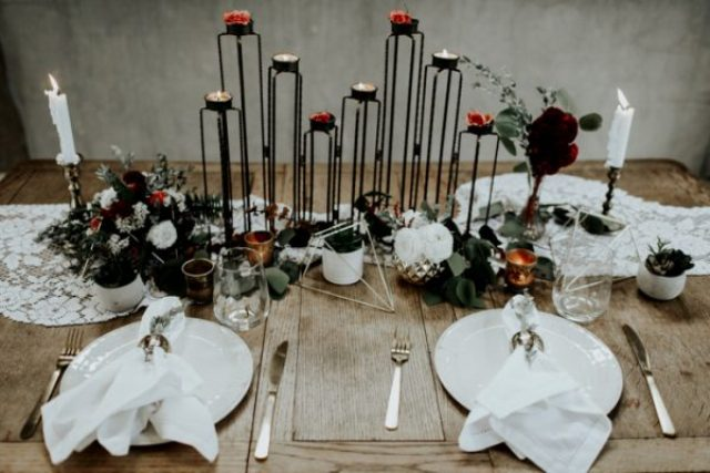 The wedding tablescape was done with a lace runner, metal candle holders, geo details and gold for a more refined feel
