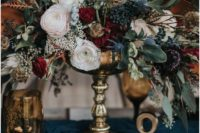 10 a lush textural wedding centerpiece with privet berries, thistles, blush and red blooms and leaves