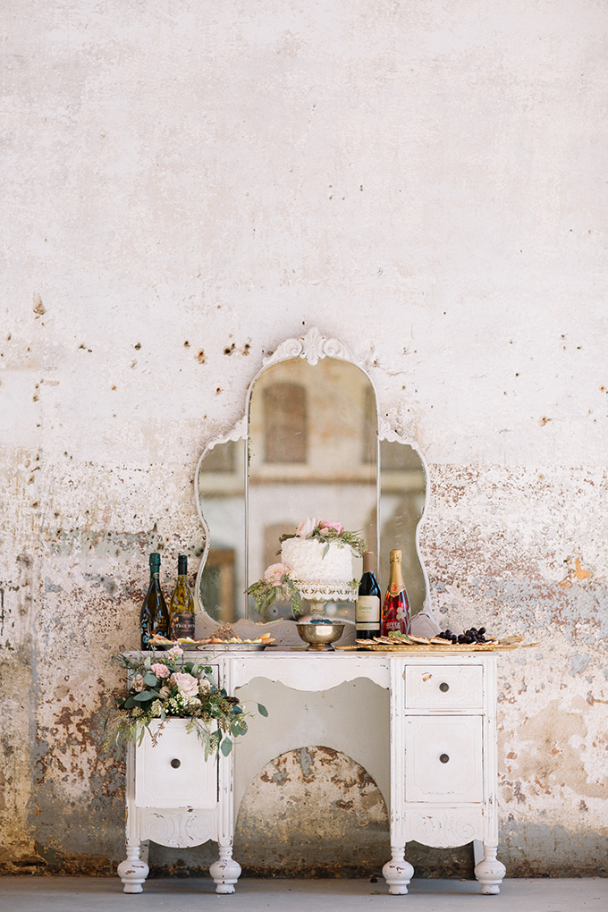 A vintage vanity table is a gorgeous idea for displaying a cake and some cheese plates