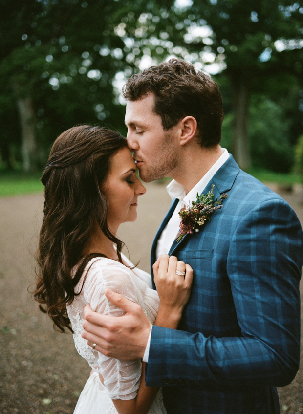 The groom was wearing a chic blue suit with a windowpane print