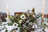 11 a vintage-inspired centerpiece with white blooms, pinecones, blush flowers, greenery and leaves, all in pale winter shades