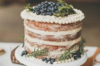 11 a yummy spiced naked wedding cake with frosting and berries
