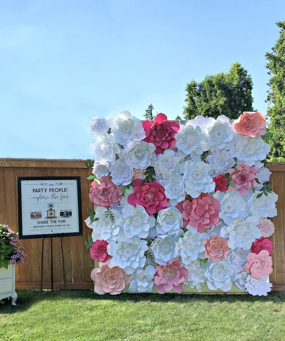 giant paper flower wall in red and white is a stunning idea for a wedding photo booth