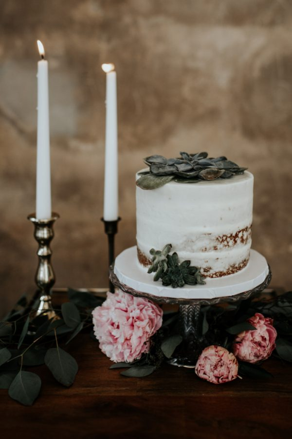The wedding cake was a naked one, with succulents