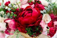 12 a bold red and pink floral centerpiece with some greenery for a hot winter wedding