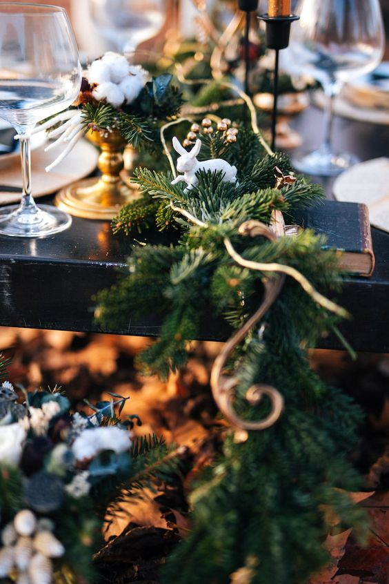 a fir table runner with copper touches and bunny figurines for a winter fairy-tale wedding