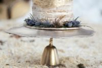 12 a naked wedding cake with gold leaf decor, blueberries and thistles looks dreamy and very winter-like