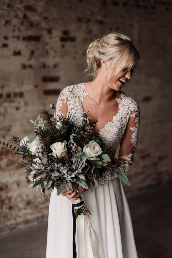 30 edgy moody winter wedding ideas weddingomania a pale bouquet with evergreens feathers white roeses and thistle for a moody winter junglespirit Image collections