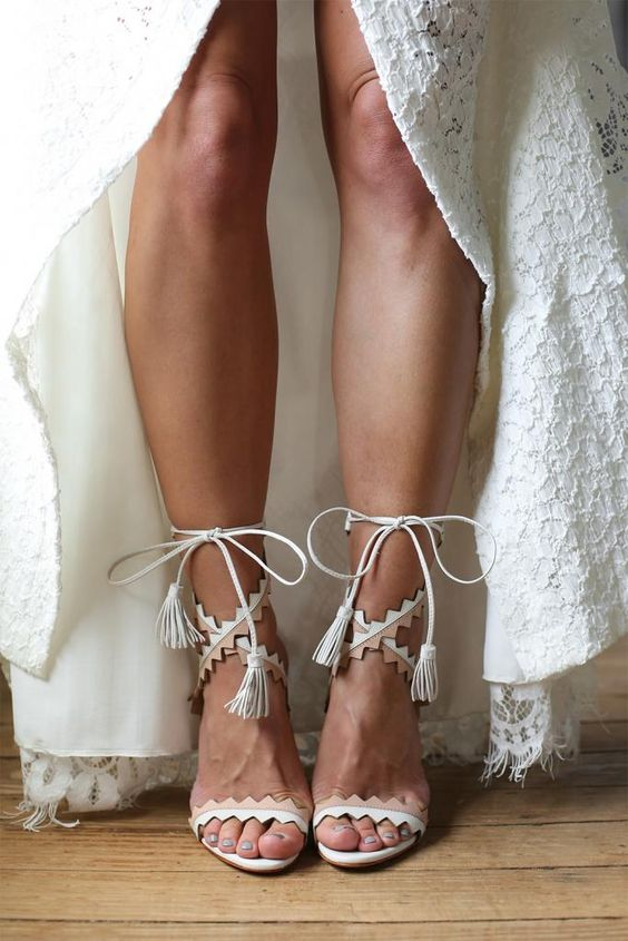 boho-inspired white and tan geo lace up heeled sandals for a boho bride