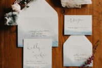 13 coastal watercolor blue wedding invitations with black letters look minimal and stylish
