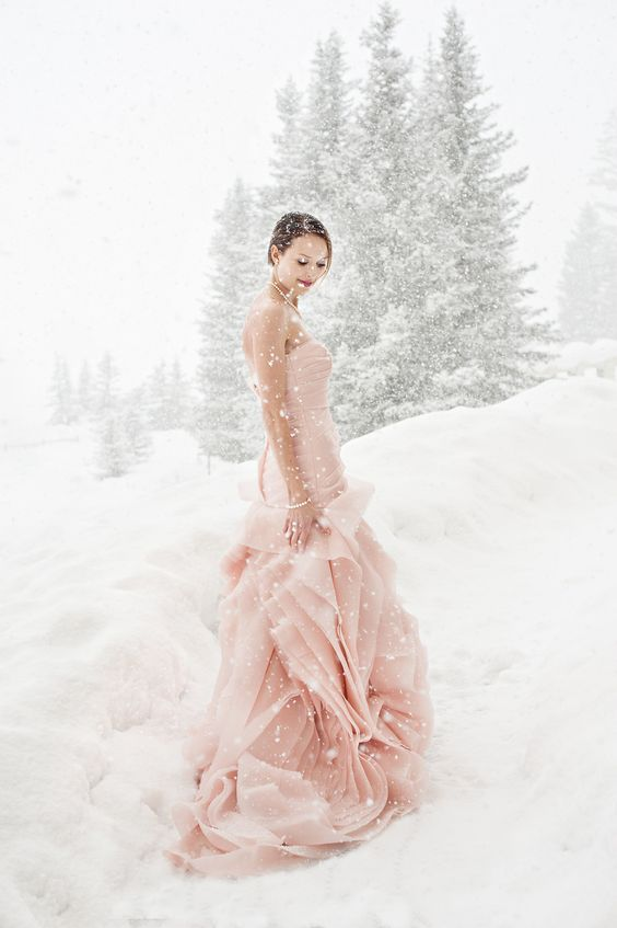 pink strapless Vera Wang wedding dress to stand out in the white snow
