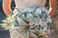 13 the air plant's bendy leaves give a unique structure to this bouquet that is rounded out with dusty miller and veronica, creating a style that is full of texture