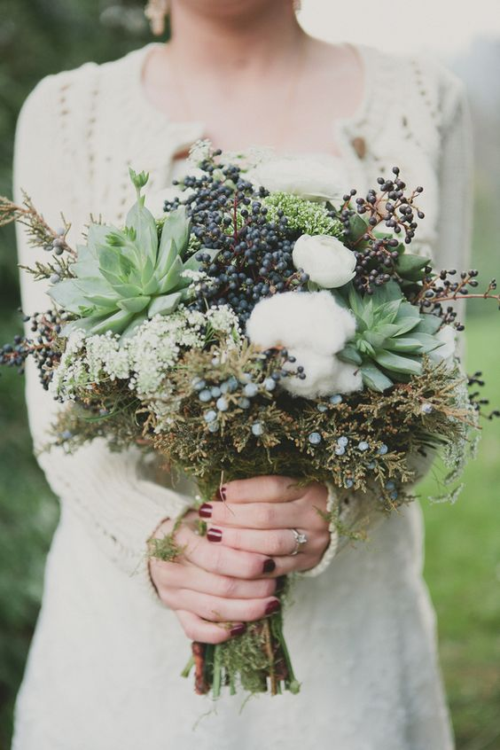 a textural bouquet with cotton, succulents, privet berries and textural foliage
