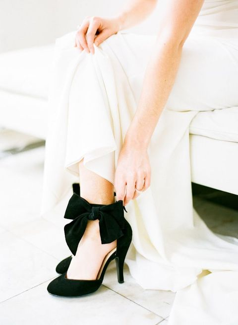 comfy and timeless black suede heels with ankle straps and large bows look very chic