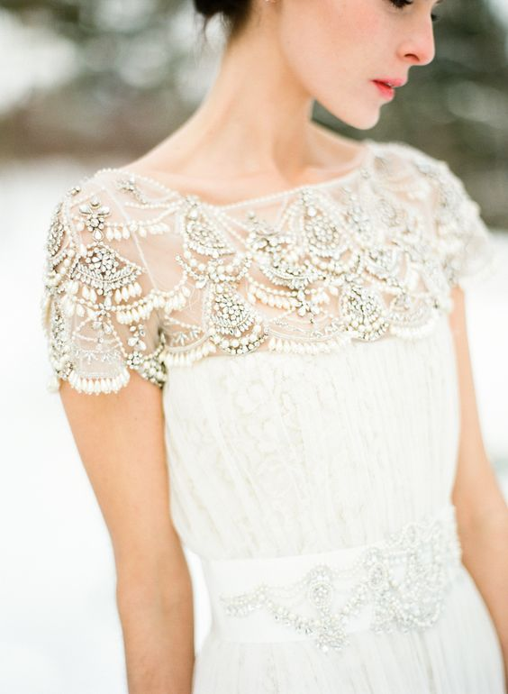 a cap sleeve wedding dress with an embellished neckline has a right amount of sparkle to look amazing