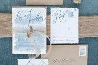 15 ethereal blue watercolor wedding invies with a raw edge and kraft paper envelopes