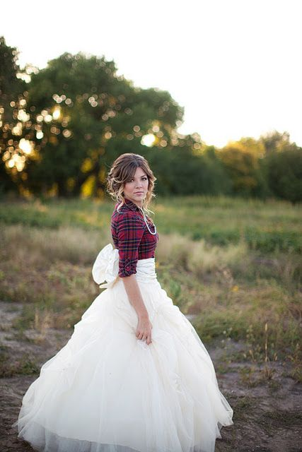 the bride rocking a plaid shirt over her wedding dress - such a cute idea for a rustic bride
