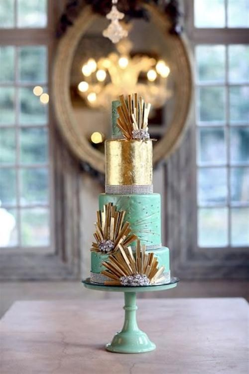 a spakly mint and gold wedding cake with rhinestones and brooches for a New Year wedding