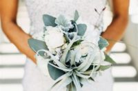 16 an air plant, pale leaves and some white blooms wedding bouquet for a non-traditional bride