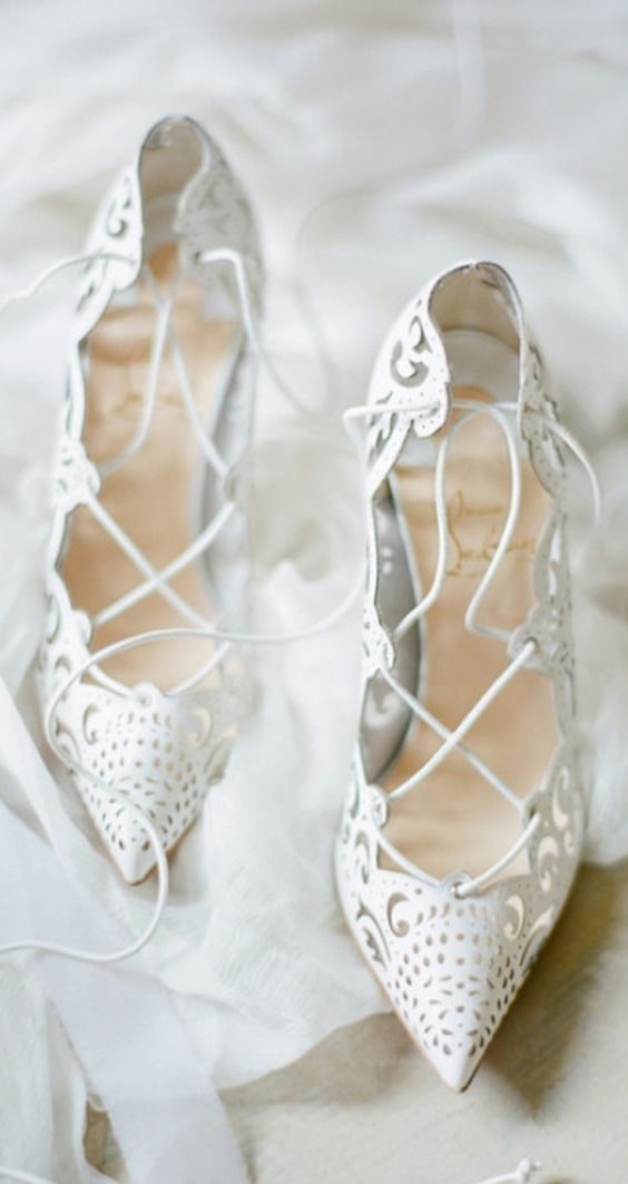 white laser cut Christian Louboutin pointed toe heels for a modern fashion-forward bride