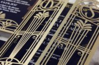 17 laser cut gatefold wedding invitations in navy, gold and white