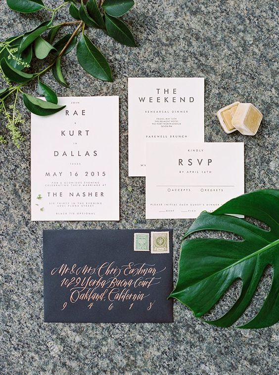 modern neutral invitations and a black envelope with copper celligraphy