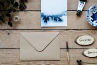17 watercolor navy blue wedding invites and craft paper envelopes will fit many different wedding themes