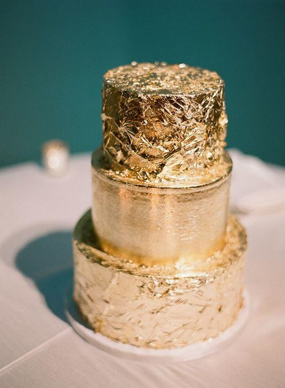 a glam gold leaf cake with two textural layers is a chic idea for a glam or New Year's wedding