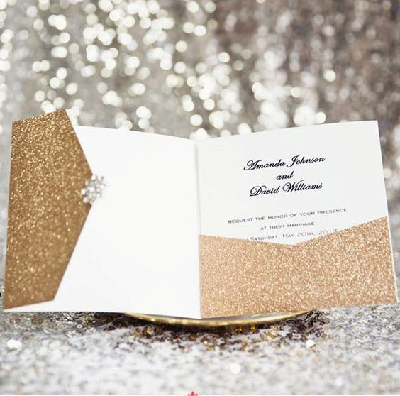 a gold glitter pocket wedding invitation for a glam Christmas wedding