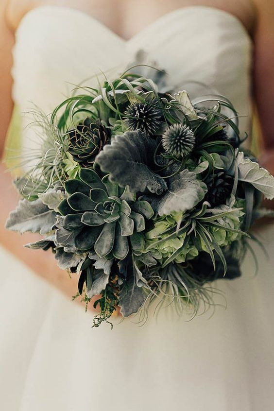 a greenery wedding bouquet with leaves, succulents, air plants and various textural foliage