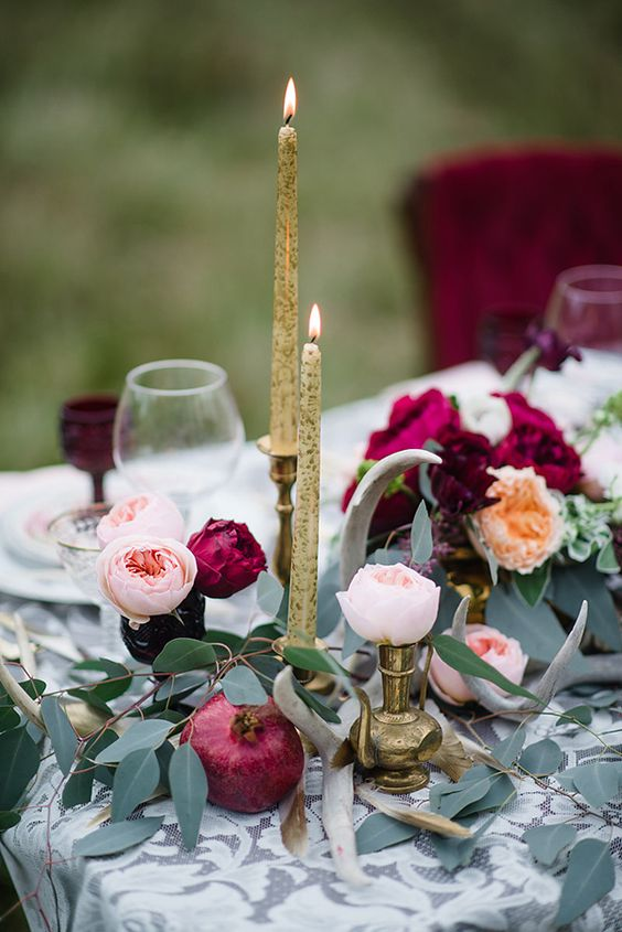 gold candles, candle holders, plum-colored blooms and greenery for a luxe tablescape
