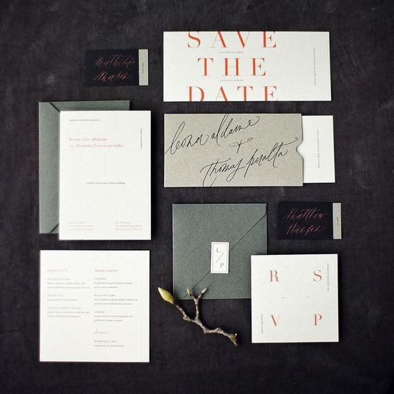 a modern wedding invitation set done in neutrals, greens and with red letters for a modern moody wedding