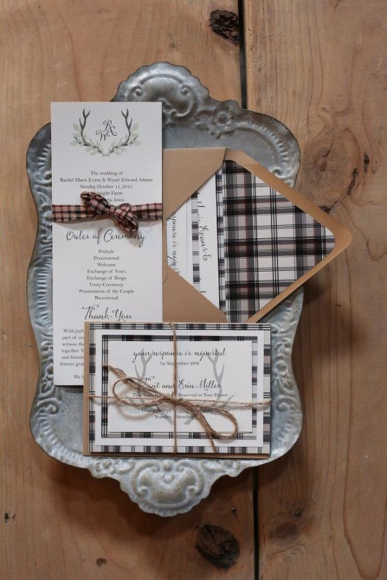 a modest Christmas invitaiton suite with a plaid print and antlers for a woodland-inspired wedding