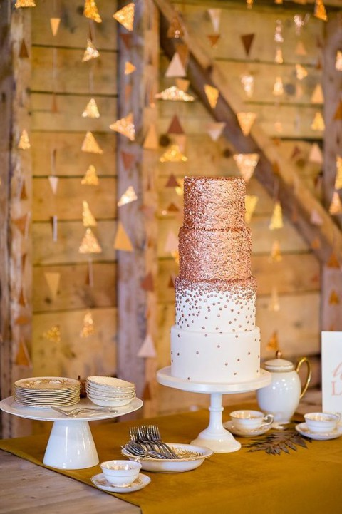 a sparkly copper wedding cake wit polka dots for a glam winter celebration